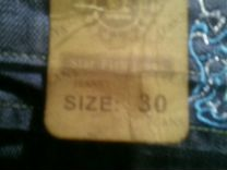 Новые джинсы женские